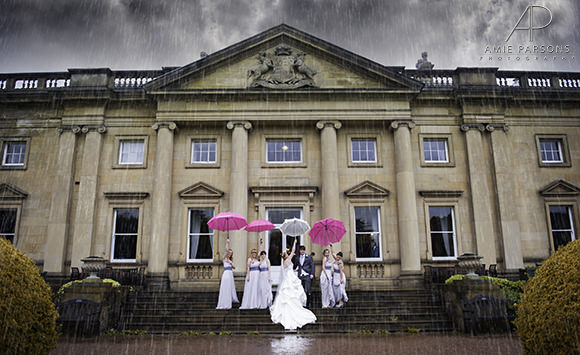 Sheffield wedding photography umbrellas rain bride and groom with bridal party